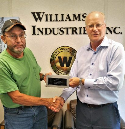 Dale Martin receiving a commemorative plaque from Art Williams.