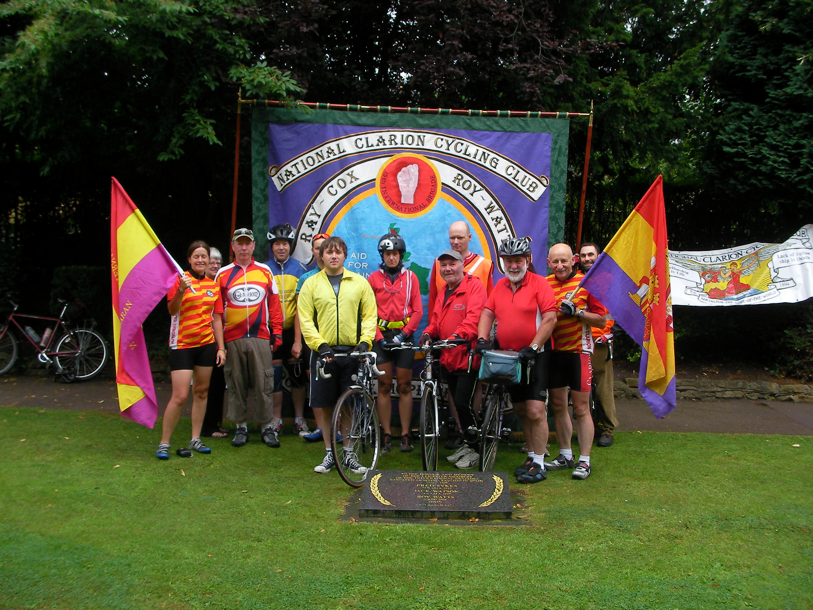 Cyclists in front of Leicester memorial