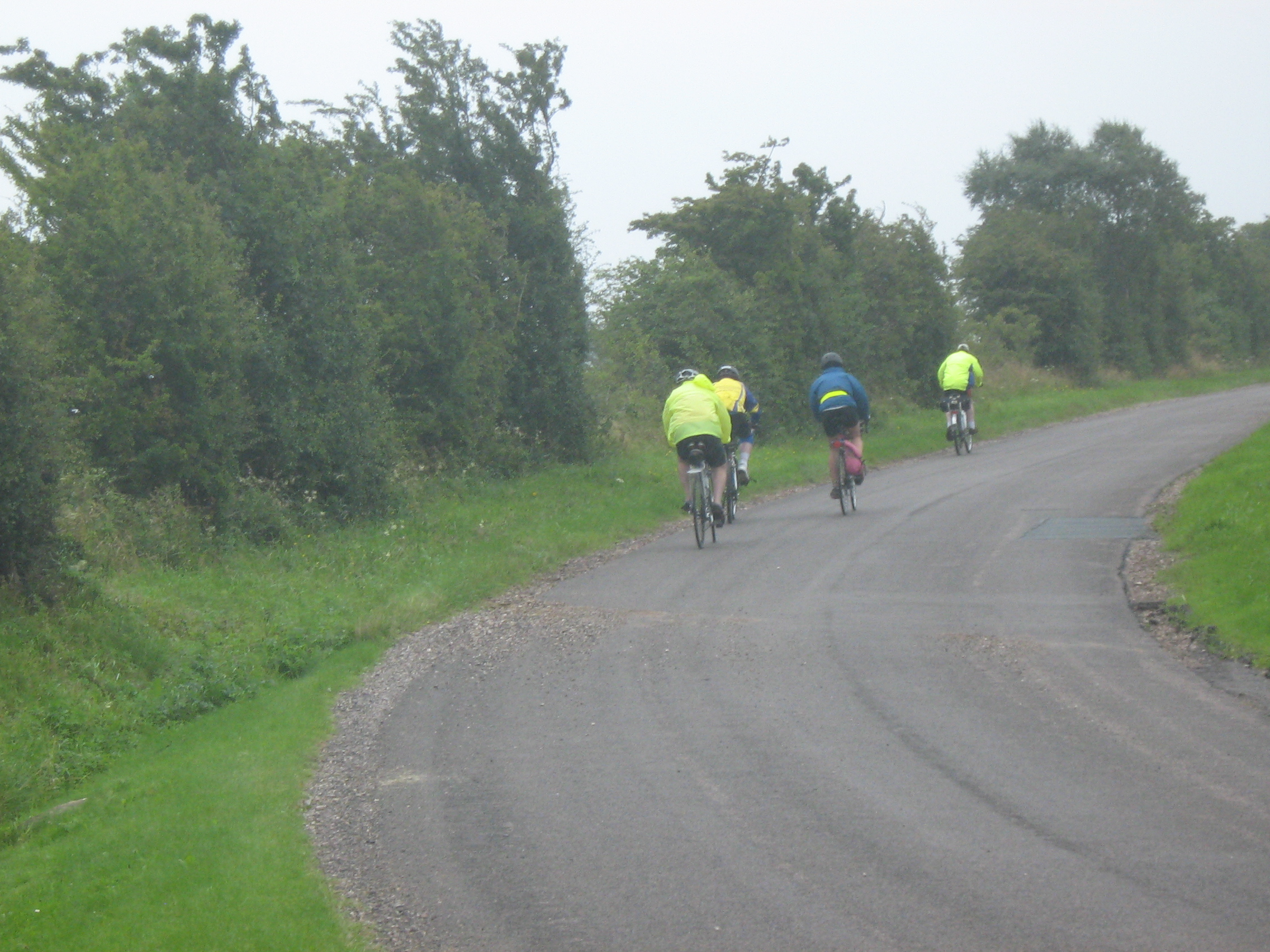 Stuart, Anna, Terry and Sid in the pouring rain between Penrith and Kirkby Stephen