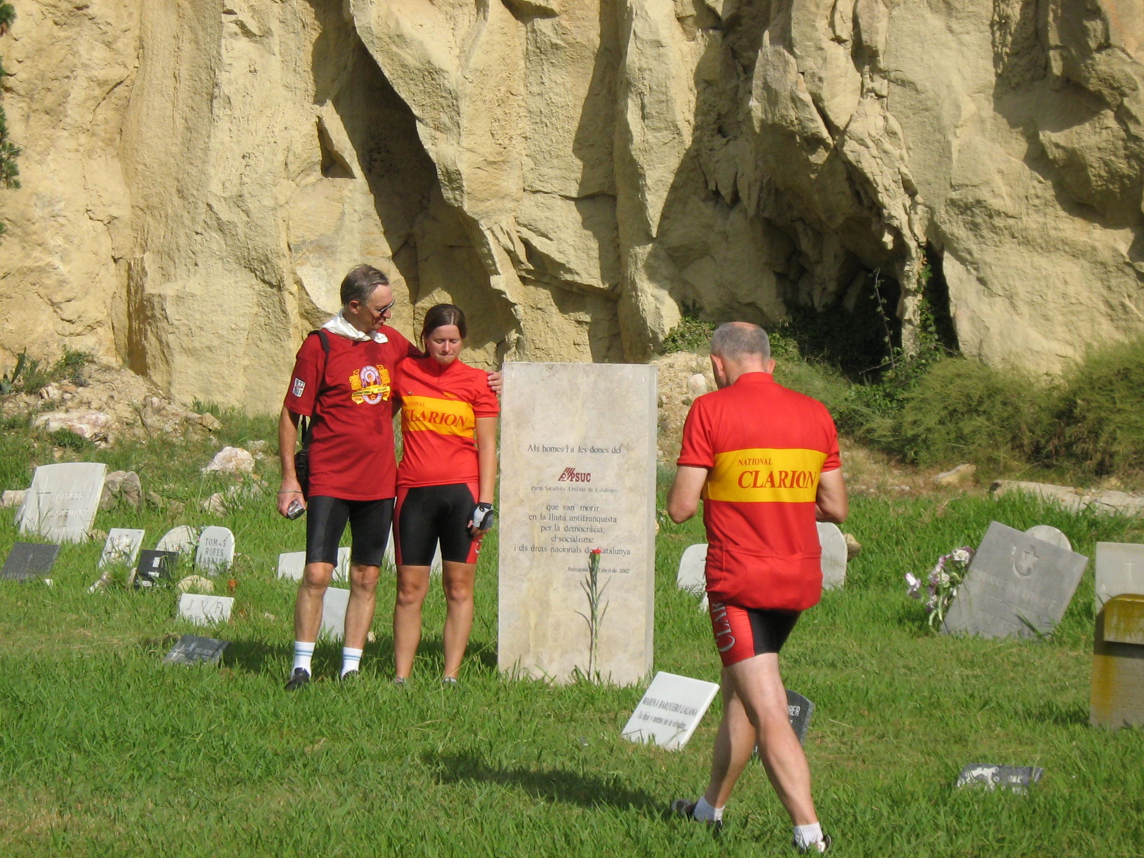 Colin beside Ruth while Charles leaves carnations at a monument to Austrian International Brigaders