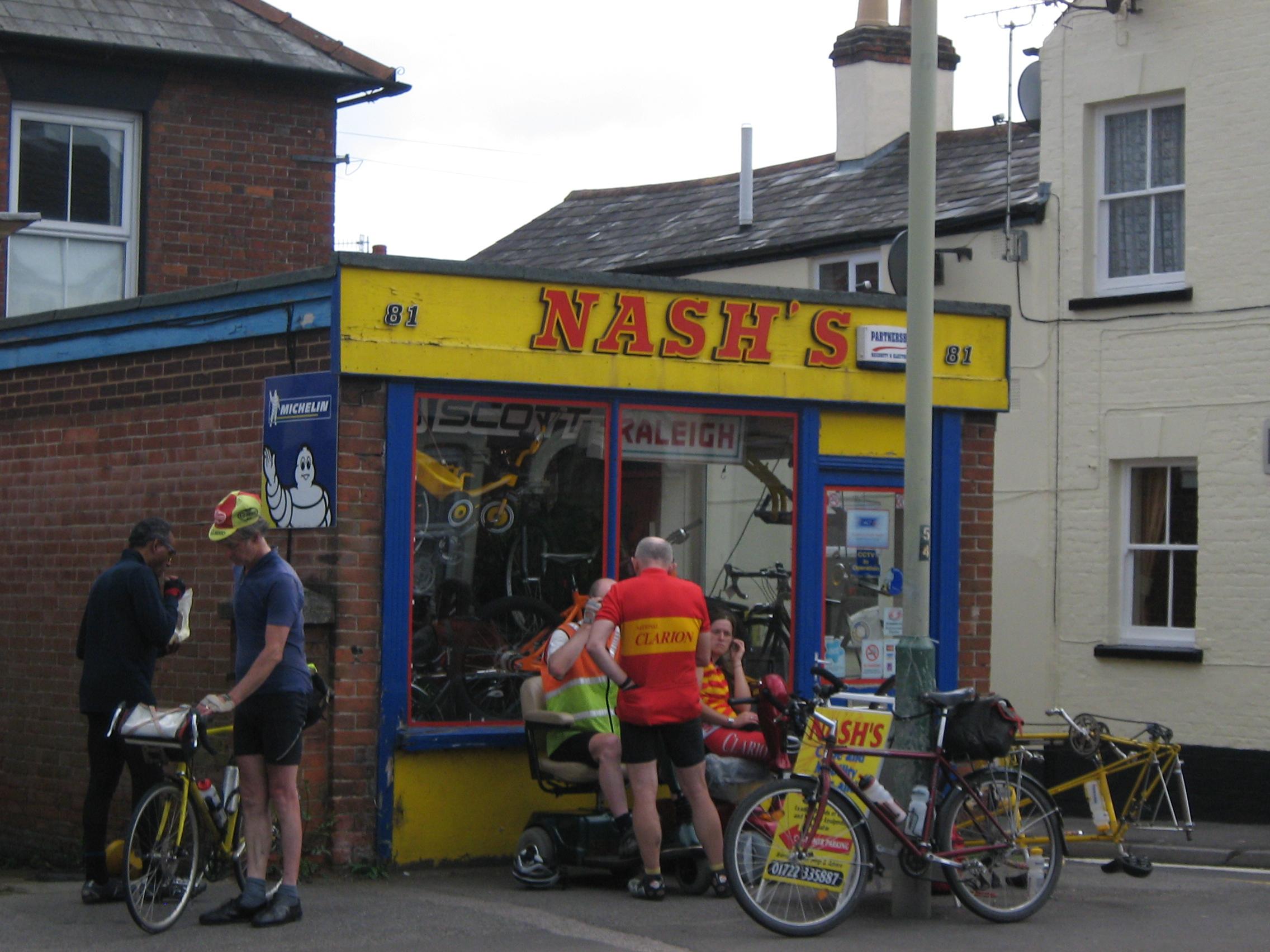 Repairing the wheel of the tandem at Nash Cycles, Salisbury