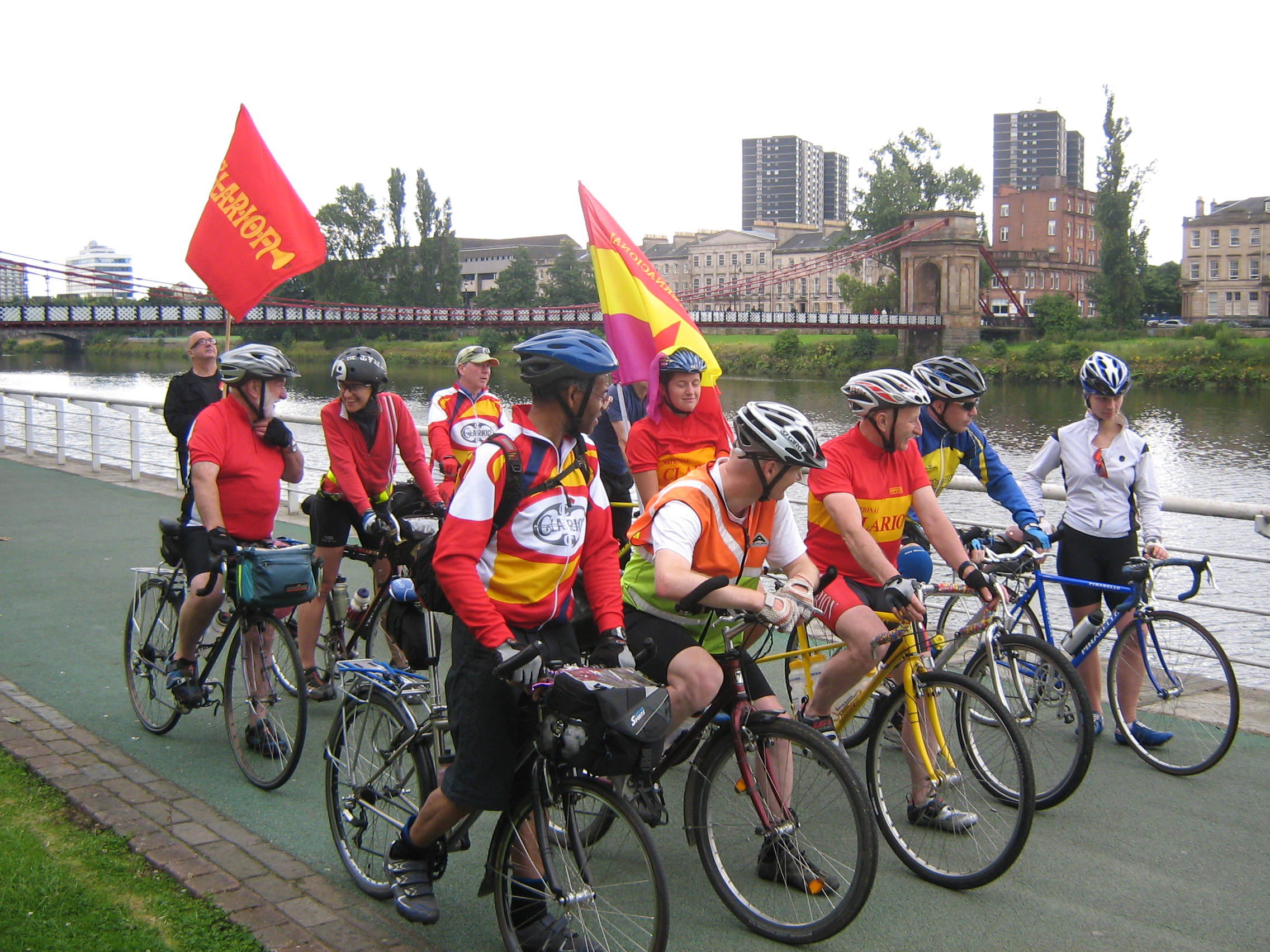 Cyclists leaving Glasgow with Jimmy Friel, President of the Scottish Printworker's Union holding the Clarion flag at the back.