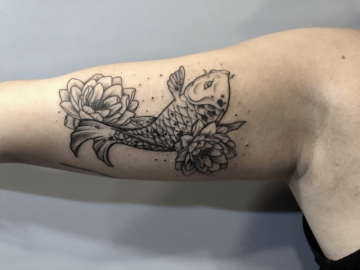 The true meaning of koi fish and lotus flower tattoo