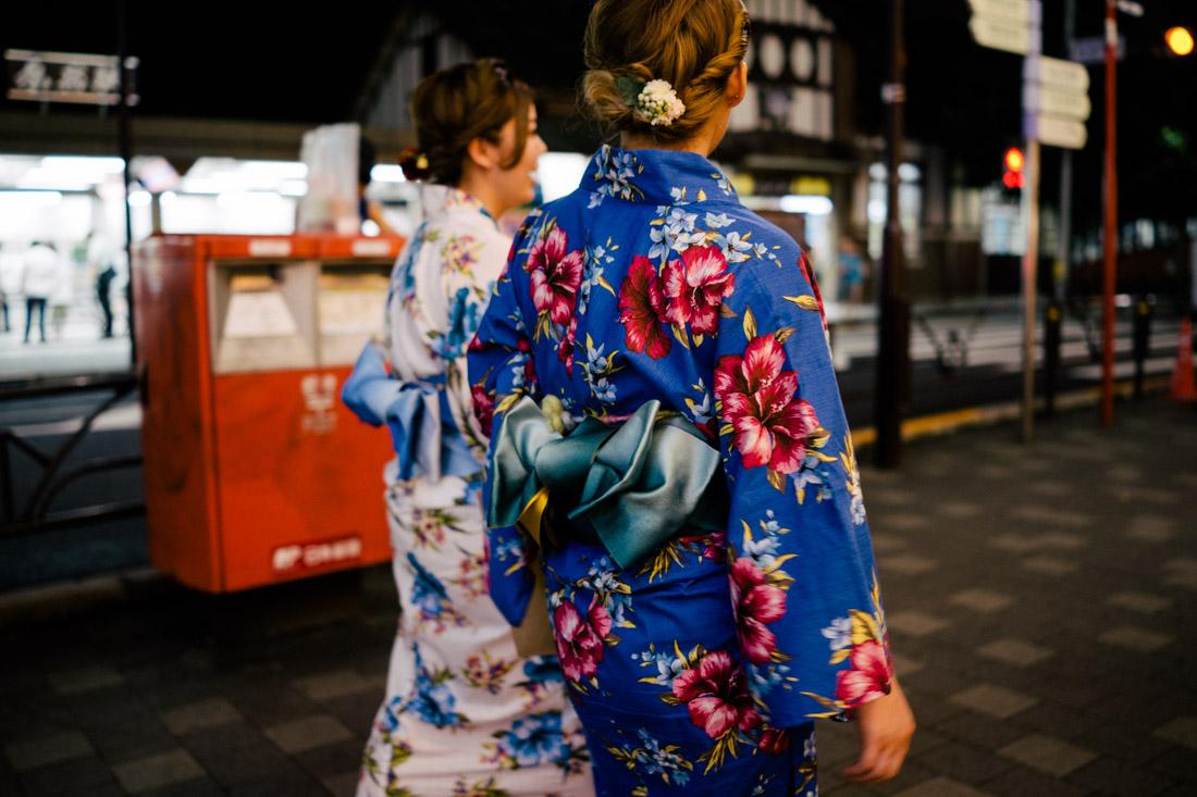 Walking kimonos late at night at Harajuku.