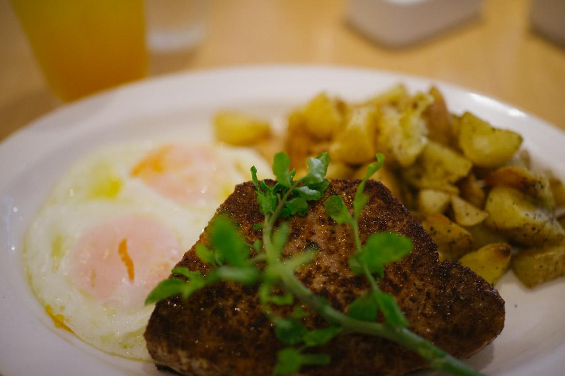 Seared ahi tuna, peppery potatoes and 2 over-easy eggs.