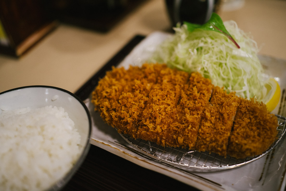 Classic Tonkatsu with finely chopped cabbage and white rice.