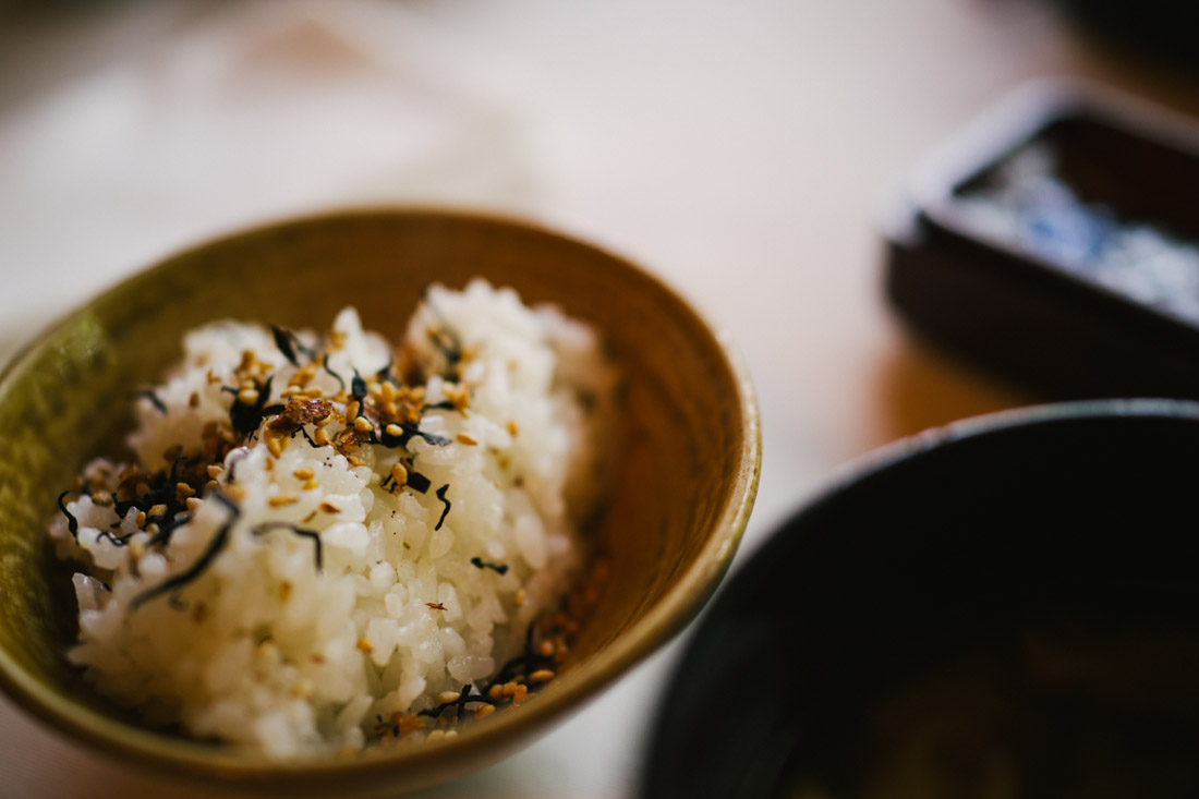 Rice topped with seaweed and sweet sesame seeds.
