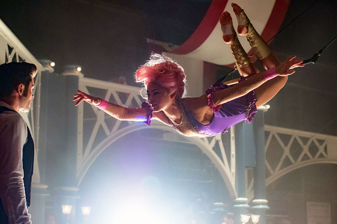 (Zac Efron) is entranced by Anne's (Zendaya) trapeze artistry in Twentieth Century Fox's THE GREATEST SHOWMAN.