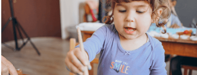 Child painting in homeschool