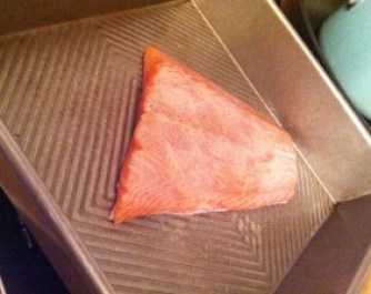 A beautiful piece of salmon fresh from the grocery store.