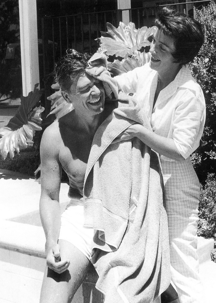 Nancy Reagan dries off her husband poolside,