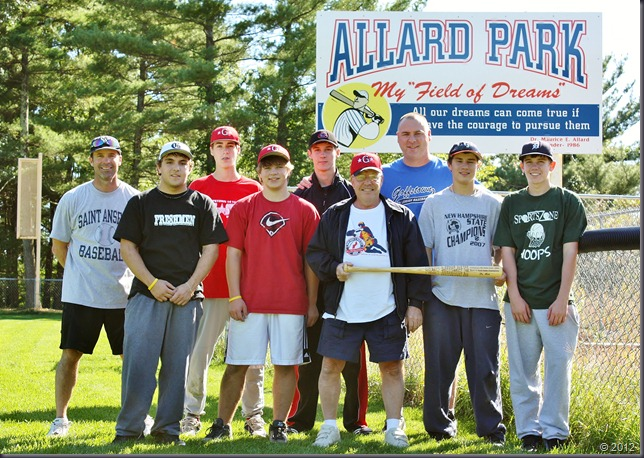 Dr. Moe and the group showing off the bat at Allard