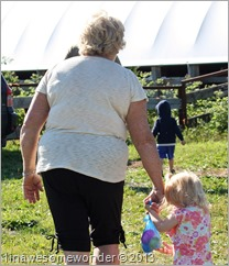 Aunt Janette leads Jacqueline up to see the calves.