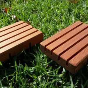 a pair of wooden soap holders