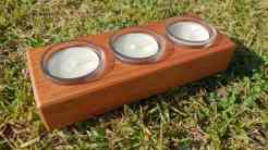 tealight candle holder with glass inserts Australian timber angle shot on grass