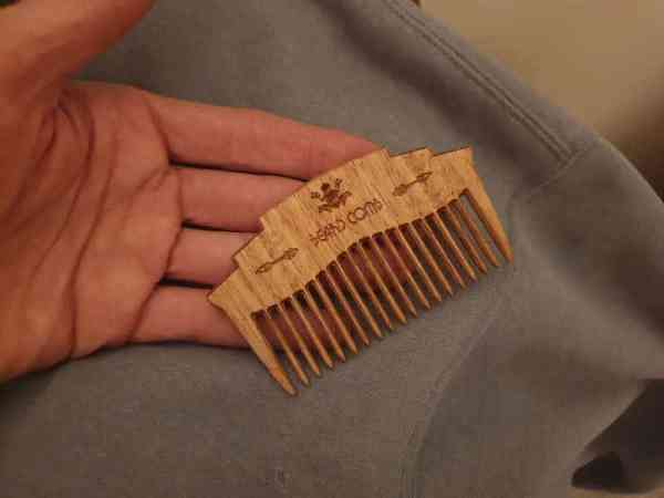 Beard Comb on cotton rag after polishing with coconut oil