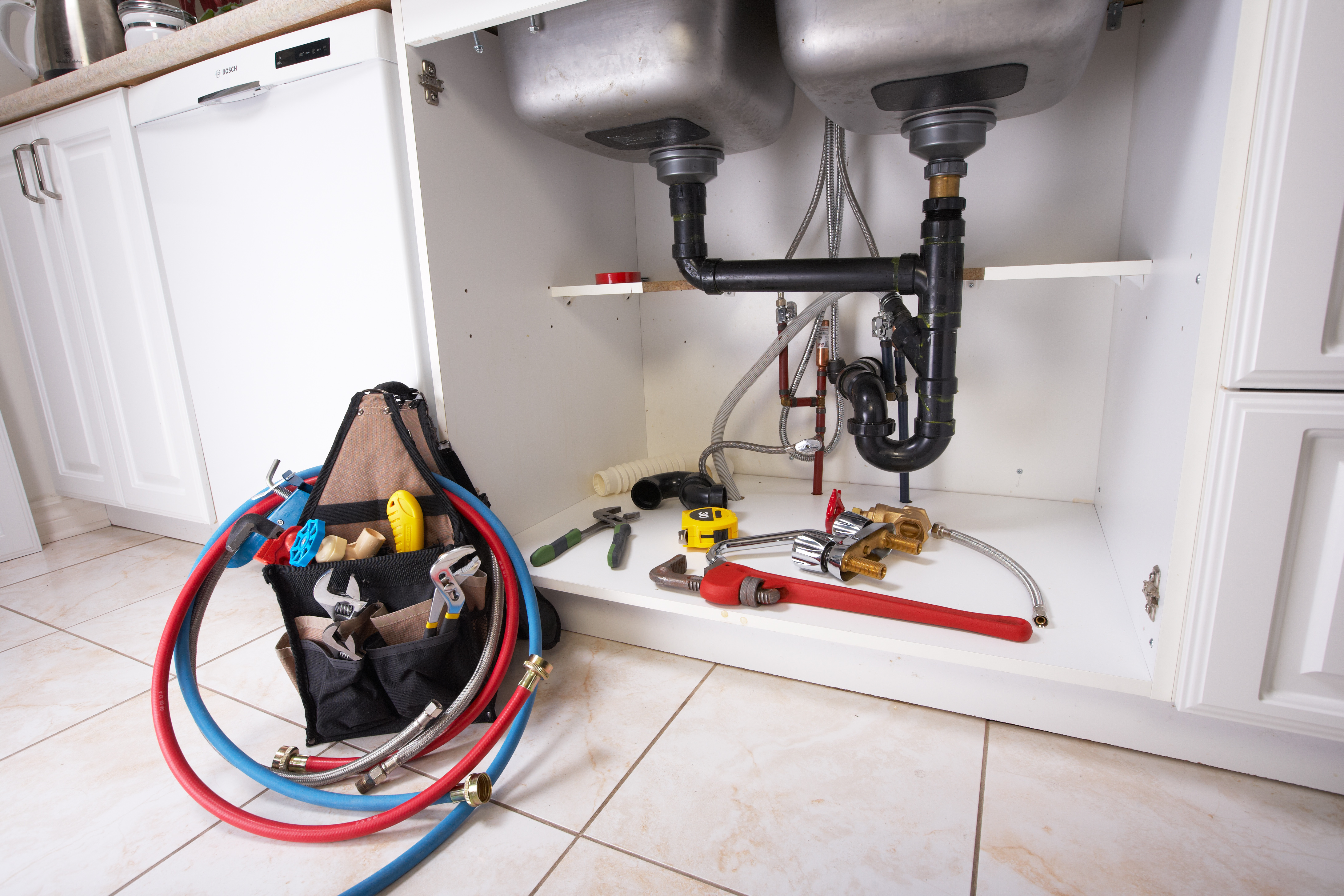 what do plumbers use to clear a clogged drain