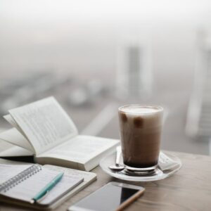 Notebooks, phone and caffe latte -by https://www.pexels.com/@dariaobymaha