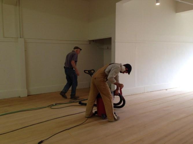 Tim and Joe sanding the original fir floors
