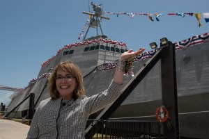 "Gabrielle ""Gabby"" Giffords waves to a crowd"