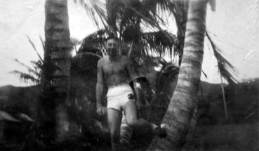 George Smith, his arm wound still bandaged, gets ready for a swim.