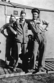 Luther Diehl, David Spohn, and Jeff Jowers pose outside Hut 10, while George Smith sneaks in the background.