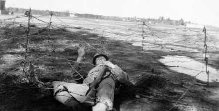 Walter Parcheta of Buffalo, NY, negotiates a barbed wire obstacle.
