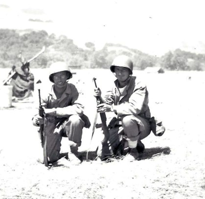 Klauss in the field with a bespectacled buddy, possibly Corpsman Schreiber.