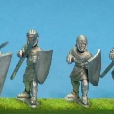 Unarmoured medieval spearmen in hoods and caps.
