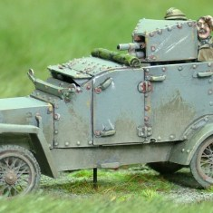 28mm 1/48 ww1 Peugeot Armoured Car with Field Gun. Peugeot Armoured Car with Field Gun. Body Cast in resin with metal parts and 2 crew figures.