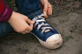 child tying his shoes
