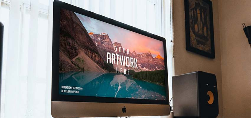 iMac on Wooden Desk