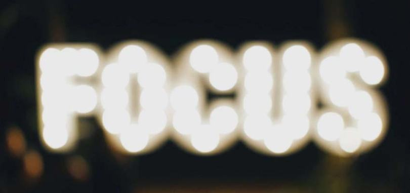"""A blurred sign that says """"FOCUS""""."""