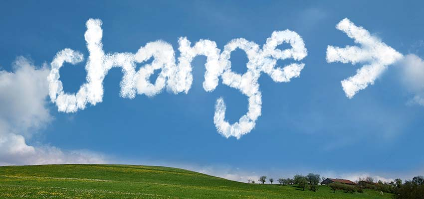 """Sky with the word """"CHANGE"""" written in clouds."""