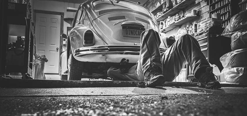 Mechanic repairing a car.