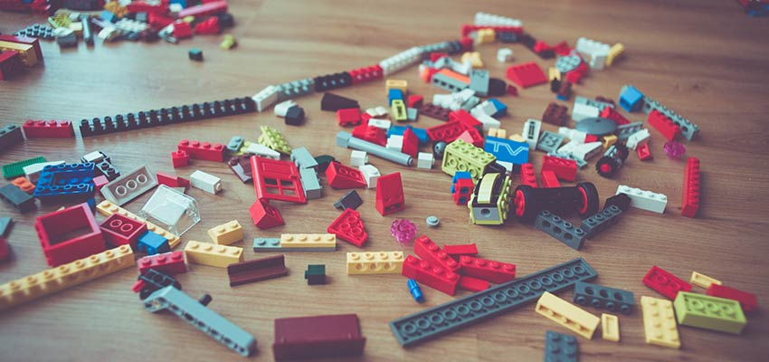 Toy blocks scattered on a floor.