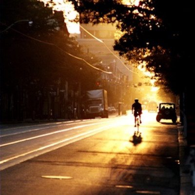 Picture of person biking in the evening time