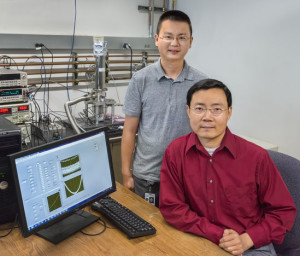 Junqiao Wu (seated) and Yang Fan showed that the flow of heat in black phosphorous nanoribbons can be very different along different directions in the crystal plane. (Photo by Roy Kaltschmidt)