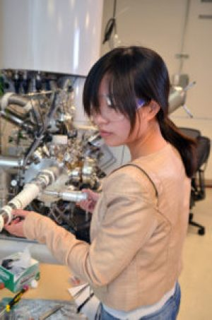 Jinhui Yang performing X-ray photoelectron spectroscopy measurements, which are used to understand the chemical properties of surfaces, at the Joint Center for Artificial Photosynthesis. (Credit: Robert Paz/Caltech)