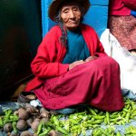 Shucking bean pods in the streets of Cuzco, Peru.
