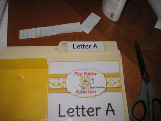 10- Laminate the small label onto the top of the folder.