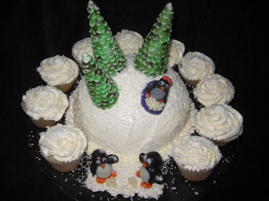 The Penguin cake with the cupcakes set all around it!