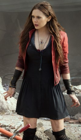 Don't know if anyone has mentioned yet but I'm 99% sure her red necklace is a kuchi coin with a red glass stone.