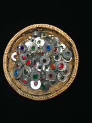Photo of a basket of multi-coloured kuchi coin pendants