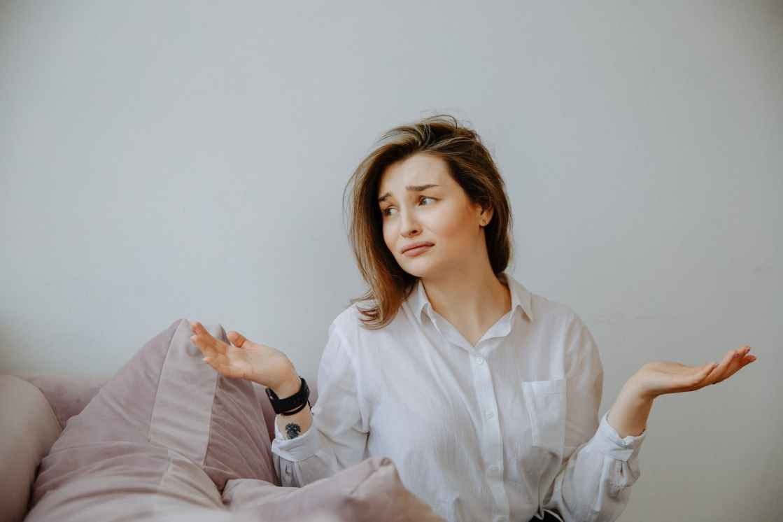 clueless woman in white dress shirt