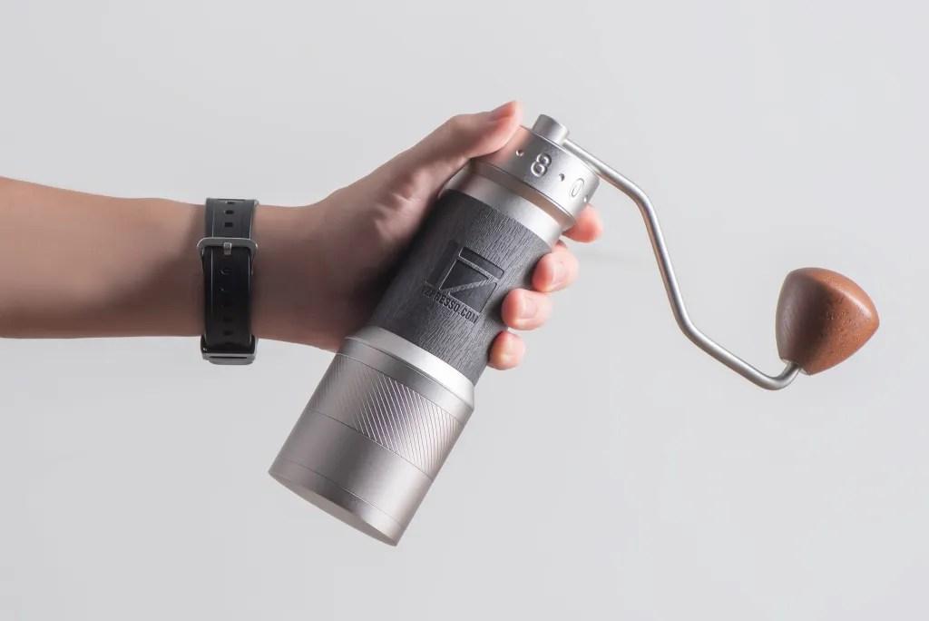 Barista holding a K-Plus grinder