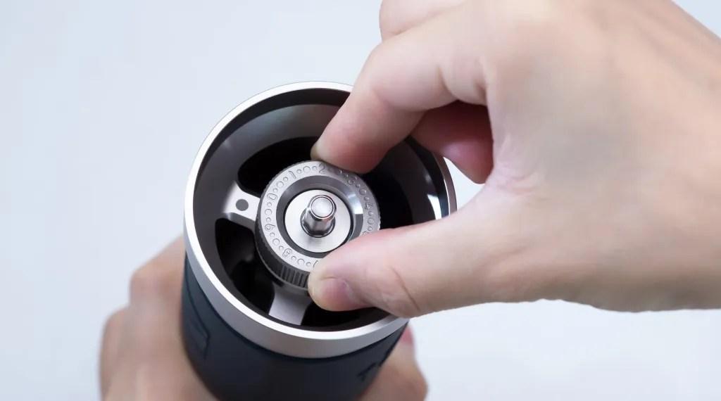 Barista adjusting the grind setting of JX-Pro grinder