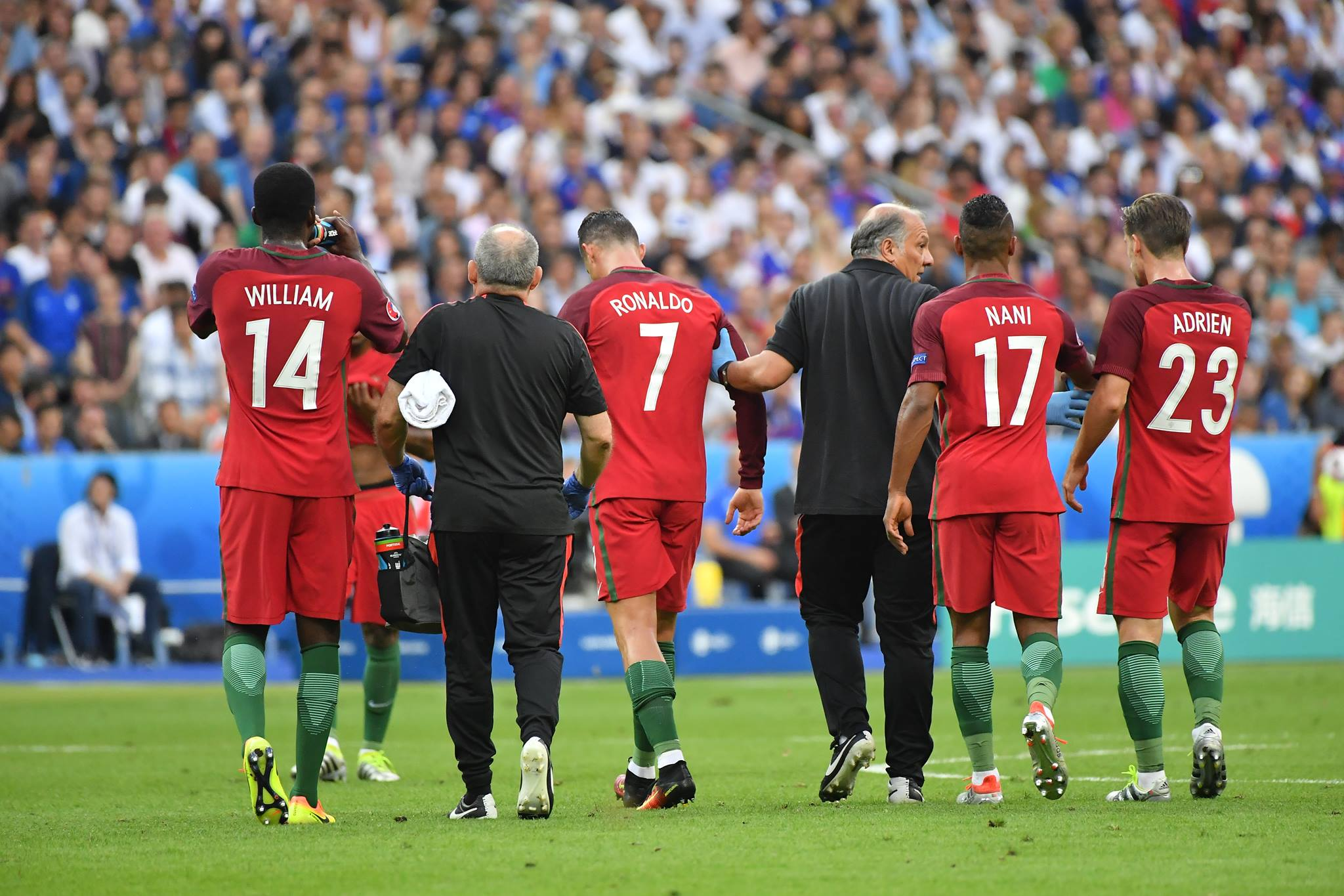Ronaldo limps off the pitch aided by the medical team. Image: PA