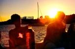 Having a sunset dinner on the boat.
