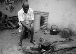 Father Fanuel, my host father, prepares morogo (wild spinach) for supper.